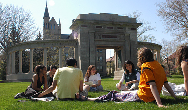 Students sitting on campus together